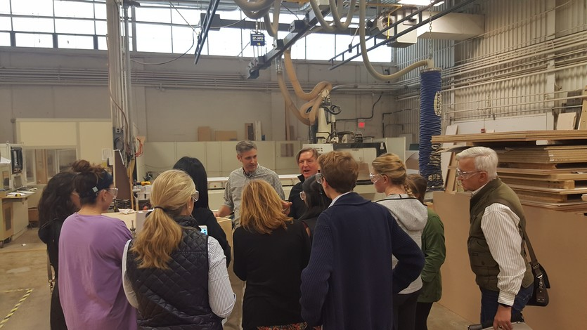 Mark gives a shop tour to Endicott College students