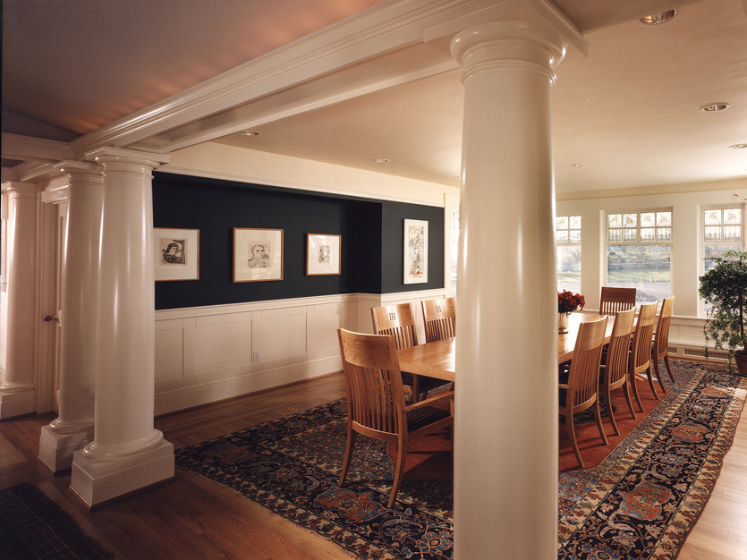 Columns and custom wainscotting adorn this beautiful dining room