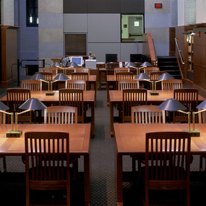 MRW built these work tables for the Widener Library at Harvard. The warm wood paneling and the custom wood furniture are a perfect combination with the cooler grey walls