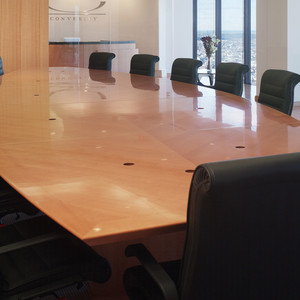 Gorgeous custom wood conference table with matching wall panels for a client in downtown Boston