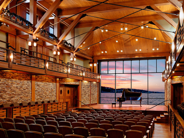 The glass wall rises behind the stage to reveal a breath-taking stretch of the Atlantic Ocean.