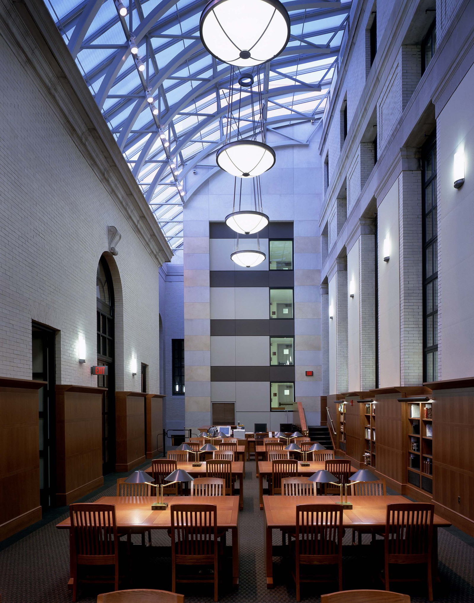 Another view of the high ceilings in the entryway. This space work so effectively. There is the grand atrium paired with the warm wood wall and furniture. The architects did an excellent job making this job timeless and so fitting for the Harvard community.