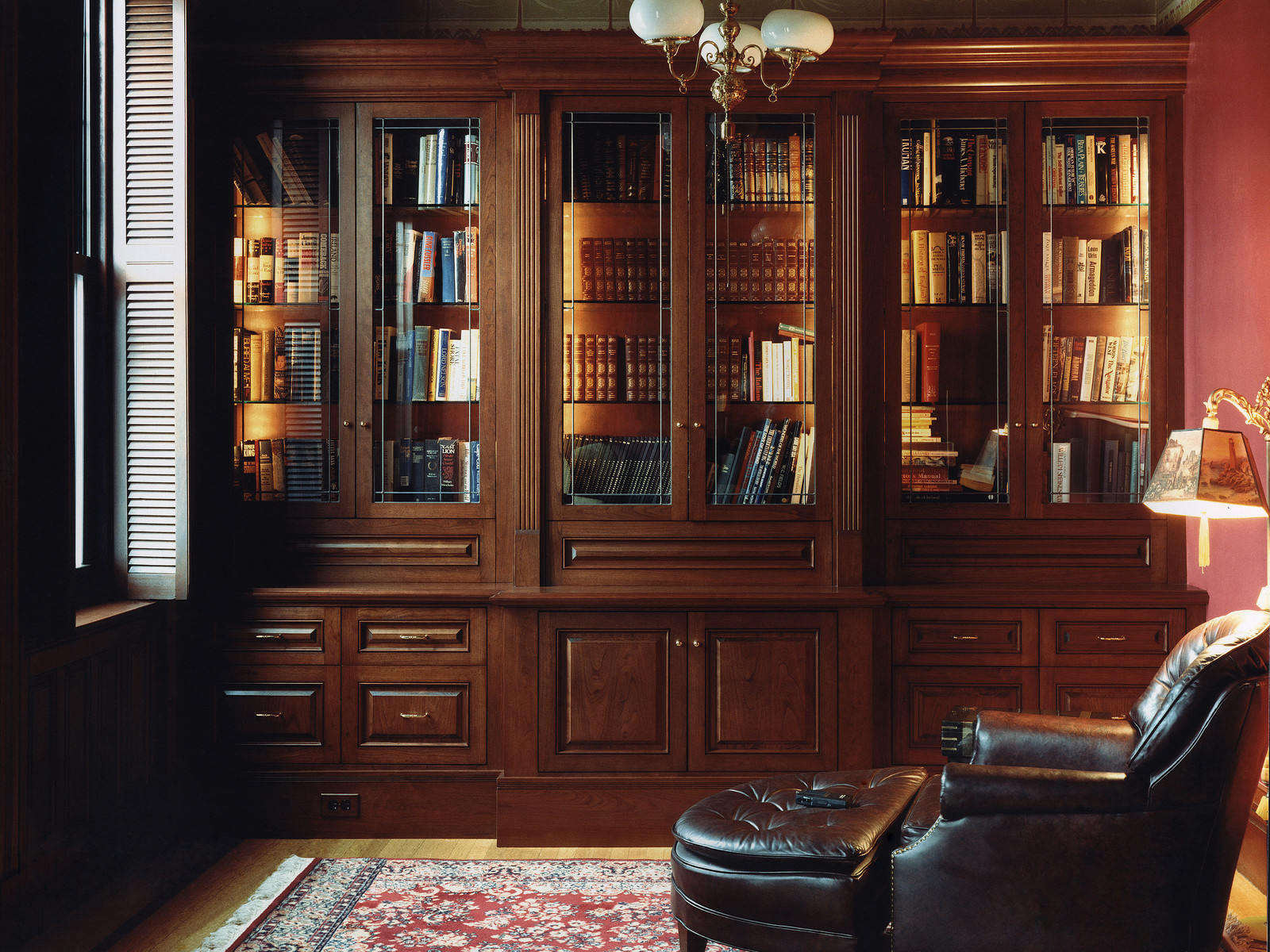 Custom built-in cabinets enhance this study