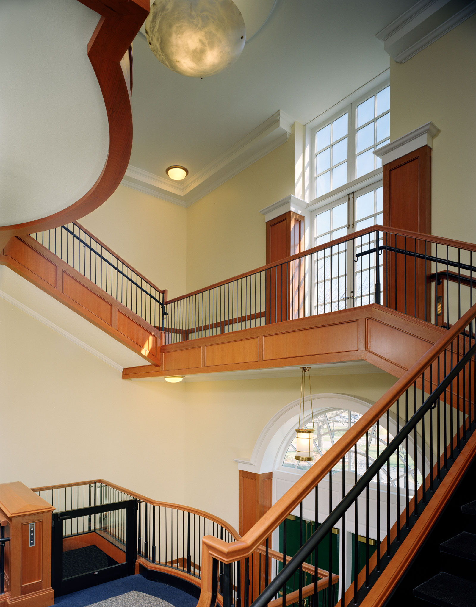 This grand stair, trim, rail and wall paneling was impeccably renovated by MRW.
