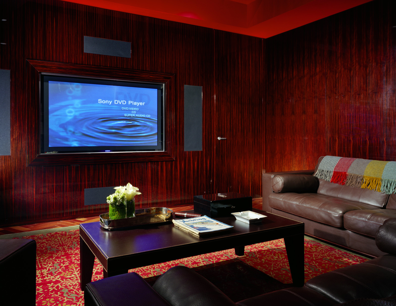 These custom wall panels make for an timeless, elegant and cozy media room