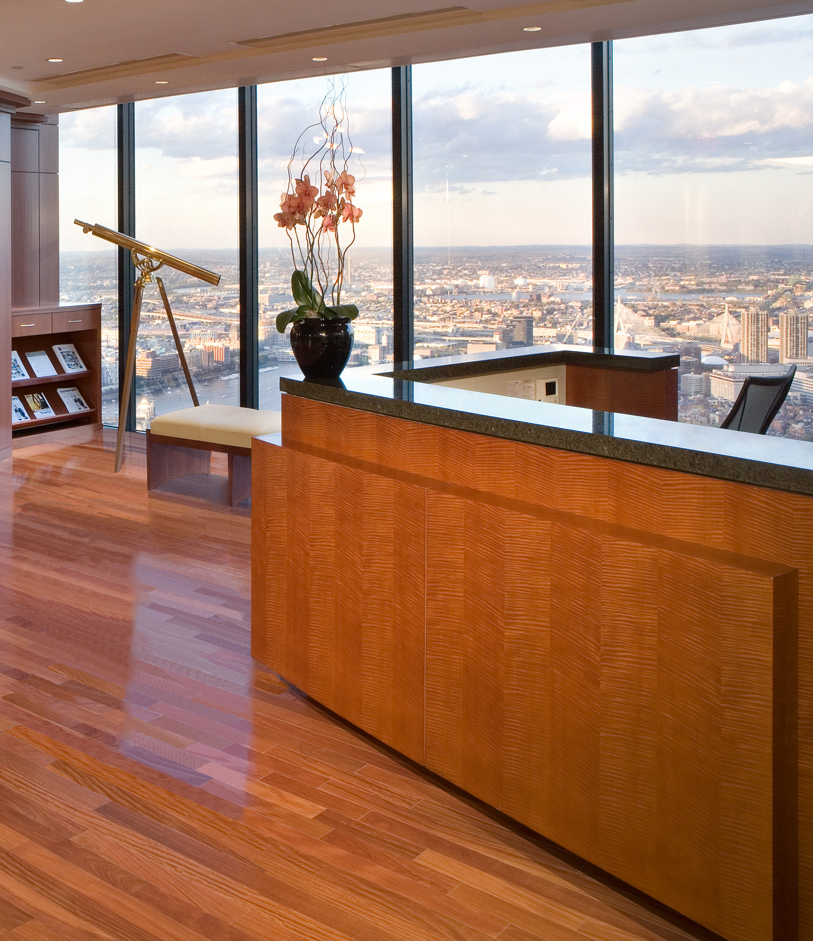 This reception desk sets the warm tone for this dramatic space in the center of Boston.